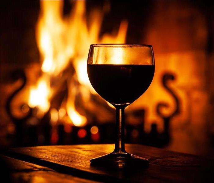 glass of wine, fire burning hearth
